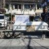 Image: STAY HOME. Officers of Brgy. 436 in Sampaloc, Manila on April 3, 2020, set up a checkpoint with a coffin on display bearing a sign, 'Stay Home or Stay Inside this Coffin' serving as a stern warning to residents during the implementation of the enhanced community quarantine. Photo by Ben Nabong/Rappler